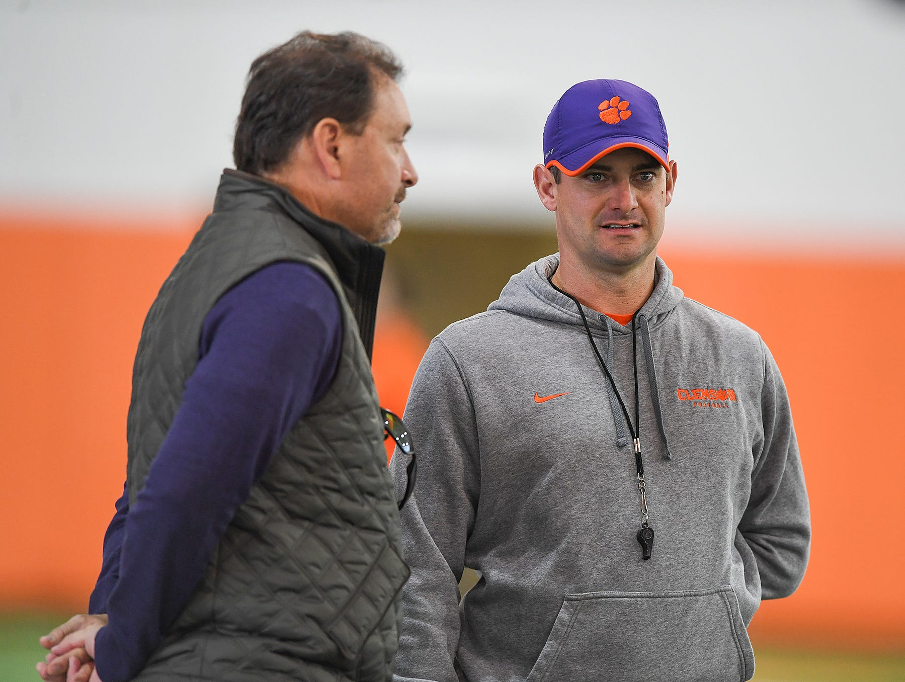 Clemson co-offensive coordinator Jeff Scott talks with former Clemson quarterback Rodney Williams during the Tigers Cotton Bowl practice on Wednesday, December 12, 2018.