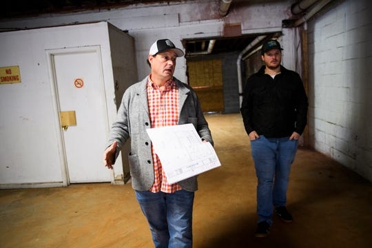 This file photo from Dec. 2018, shows Josh Beeby walking through the interior space before Burrow was finished.