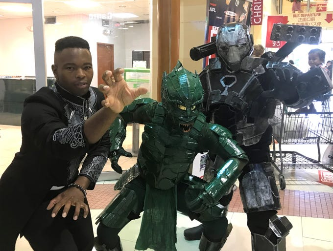 From left: Gabriel Hill (Black Panther), Venzer Patio (Green Goblin) and Phillp Lopez, (War Machine) pose at the 2018 Herocon on Dec. 9.