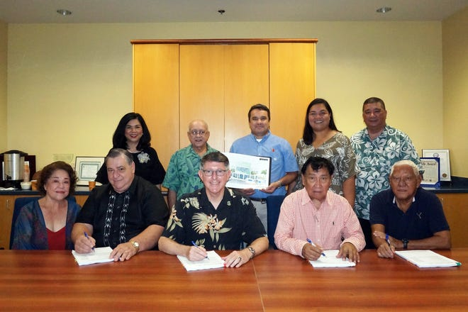 The University of Guam signed a contract with Bascon Corp. on Nov. 29 for the construction of the School of Engineering building. (Standing, from left) Anita Borja Enriquez, senior vice president of UOG; Shahram Khosrowpanah, dean of the School of Engineering; David Hurchanik, architect with David Hurchanik Architect LLC; Melanie Mendiola, executive director of the UOG Endowment Foundation; Joseph M. Diego, area director – rural development for the U.S. Department of Agriculture; (seated, from left) Elaine Jones, board member of the UOG Endowment Foundation; Christopher K. Felix, chairperson of the UOG Board of Regents; Thomas W. Krise, president of UOG; Eduardo Suarez, president of Bascon Corp.; and Wilfred P. Leon Guerrero, chairman of the UOG Endowment Foundation.