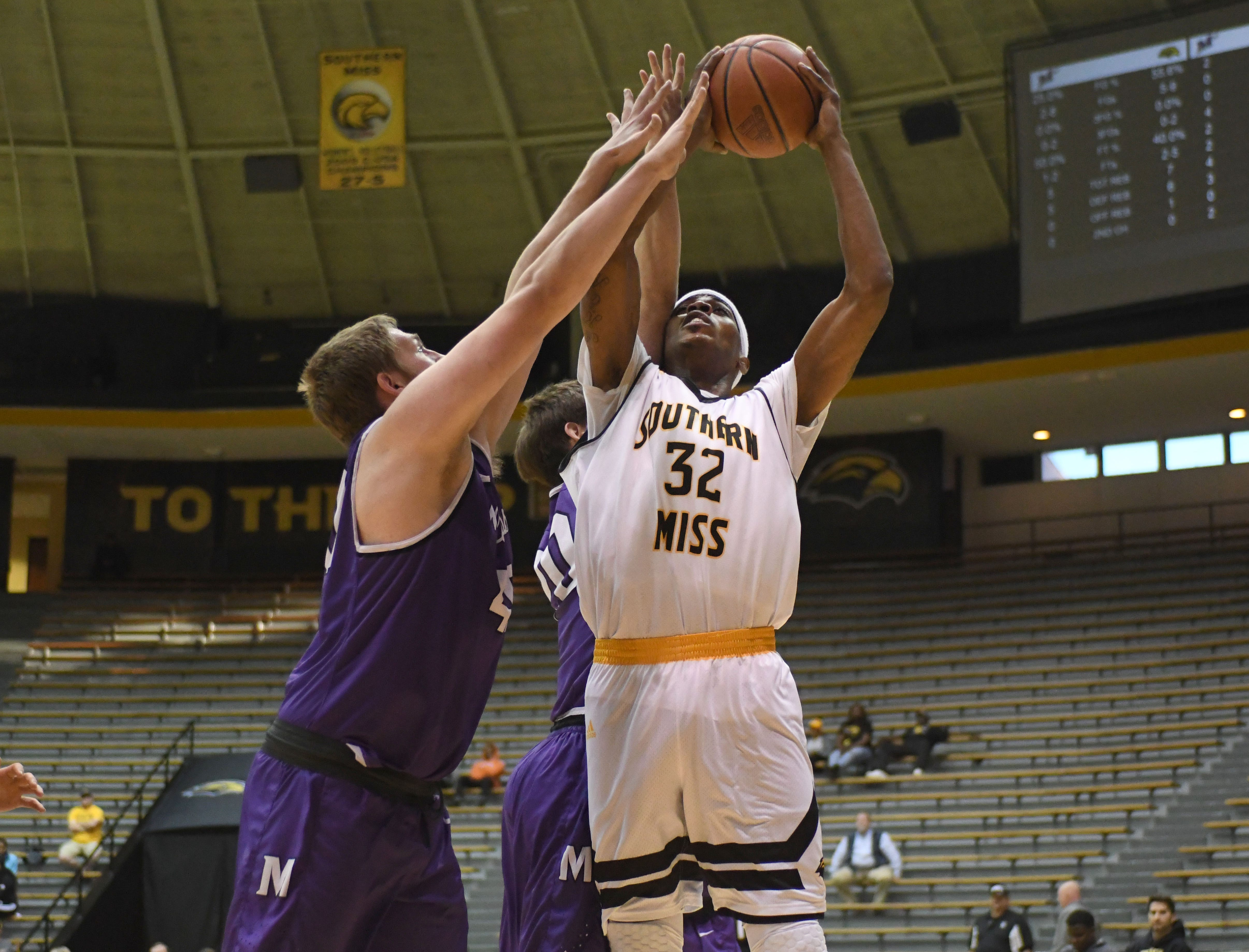 Southern Miss forward Leonard Harper-Baker shoots for the basket in a game against Millsaps in Reed Green Coliseum on Tuesday, December 11, 2018.