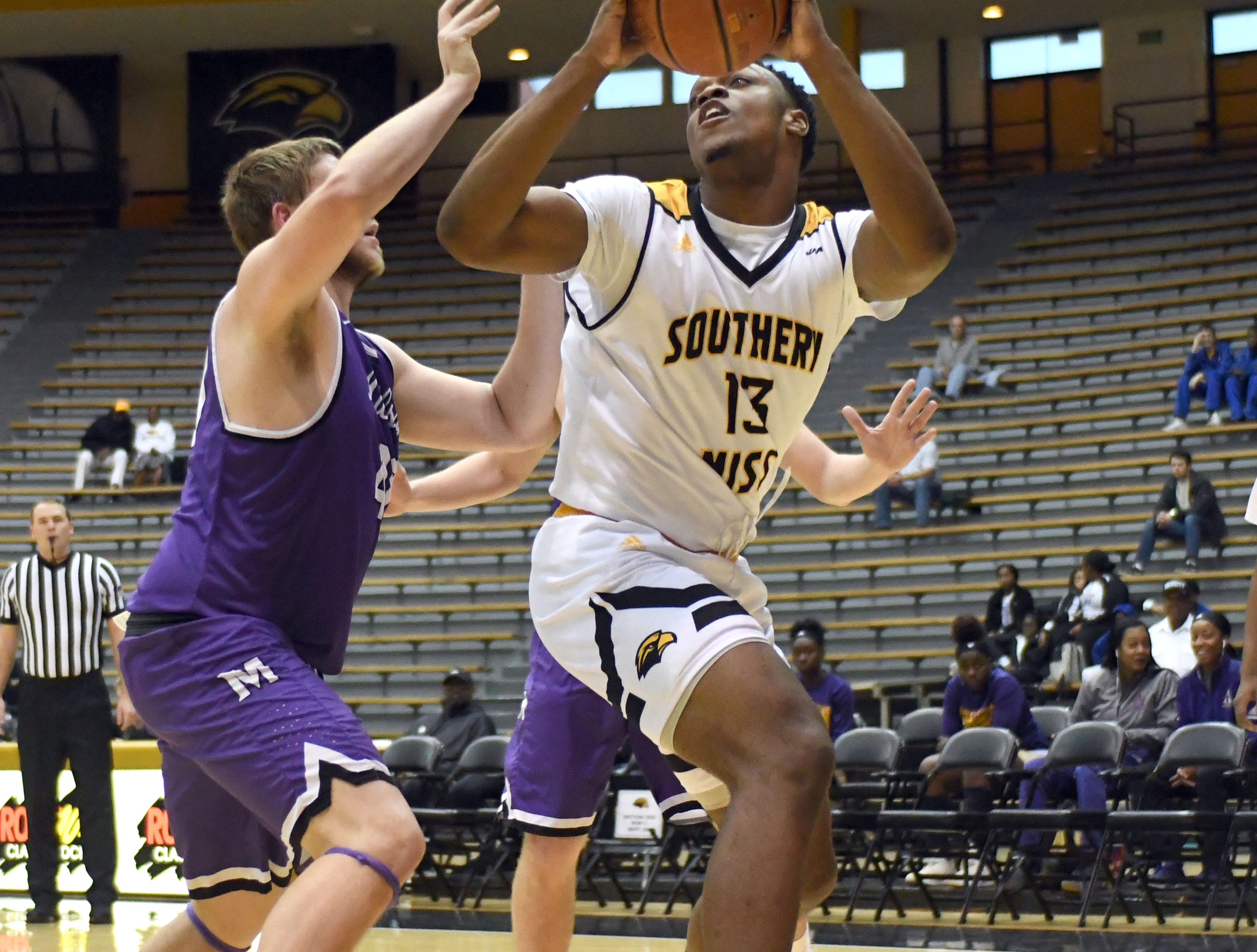 Southern Miss forward Boban Jacdonmi shoots for the basket in a game against Millsaps in Reed Green Coliseum on Tuesday, December 11, 2018.