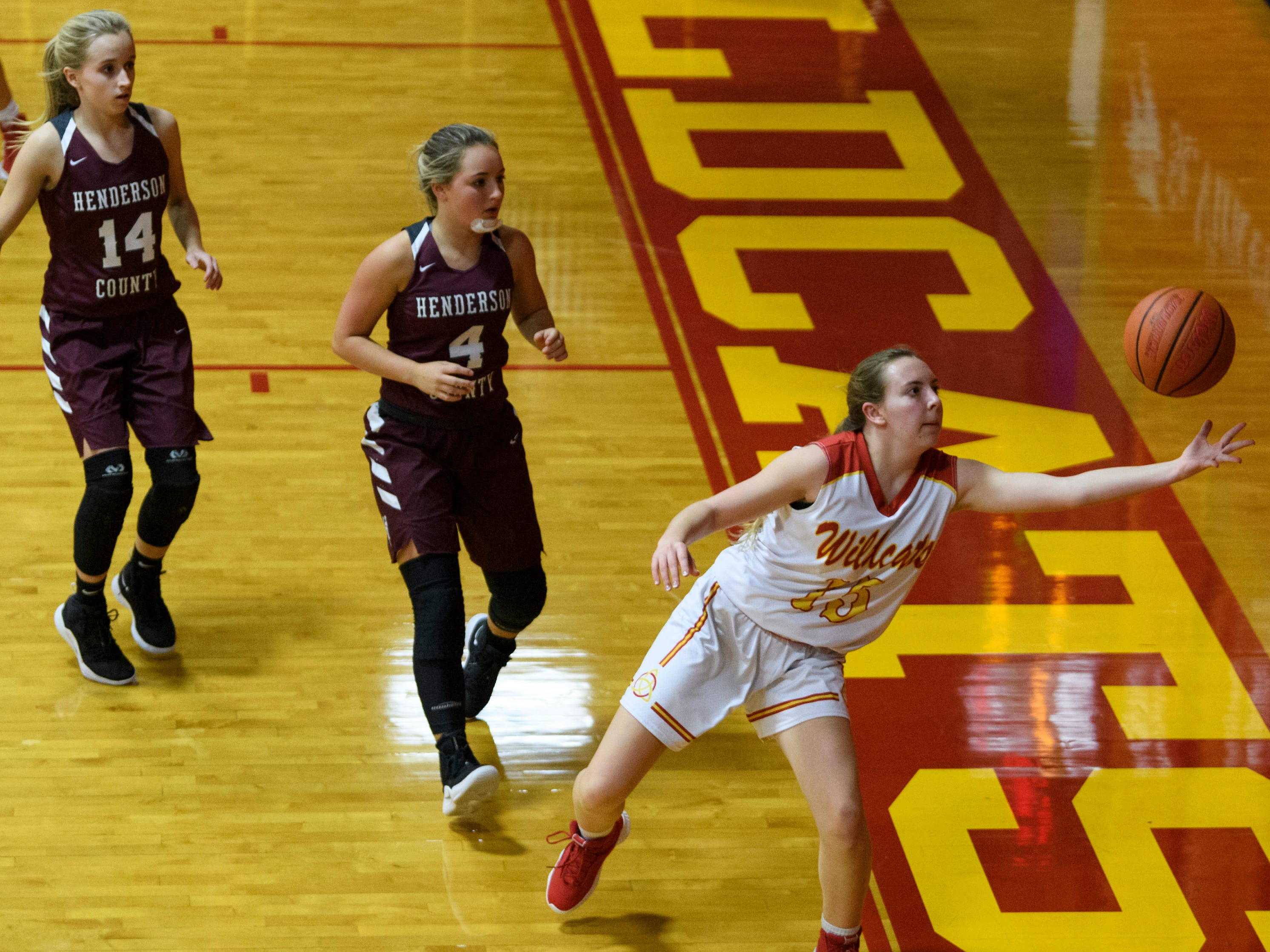 Mater Dei's Taylor Gerth (15) saves the ball from going out of bounds during the fourth quarter against the Henderson County Lady Colonels at Mater Dei High School in Evansville, Tuesday, Dec. 11, 2018. The Lady Colonels defeated the Wildcats 53-40.