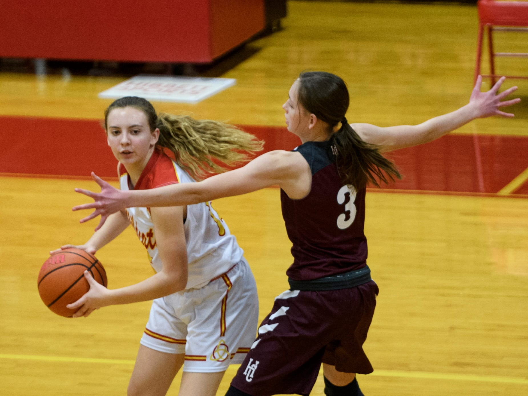 Henderson County's Jarie Thomas (3) guards Mater Dei's Taylor Gerth (15) during the fourth quarter at Mater Dei High School in Evansville, Tuesday, Dec. 11, 2018. The Lady Colonels defeated the Wildcats 53-40.