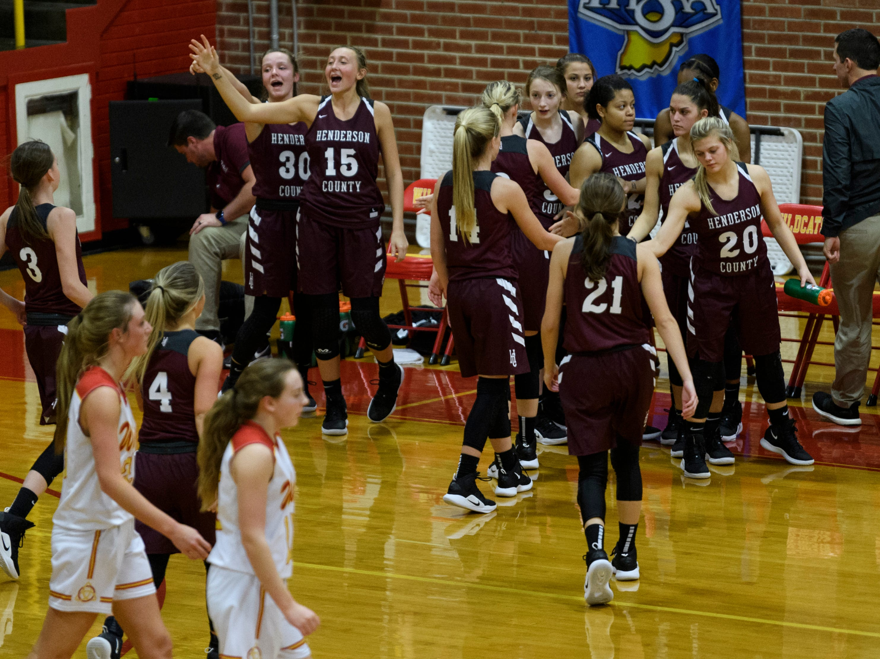 677Henderson County's Emilee Hope (30) and Alyssa Dickson (15), top left, cheer as their team seals a 53-40 victory over the Mater Dei Wildcats at Mater Dei High School in Evansville, Tuesday, Dec. 11, 2018.