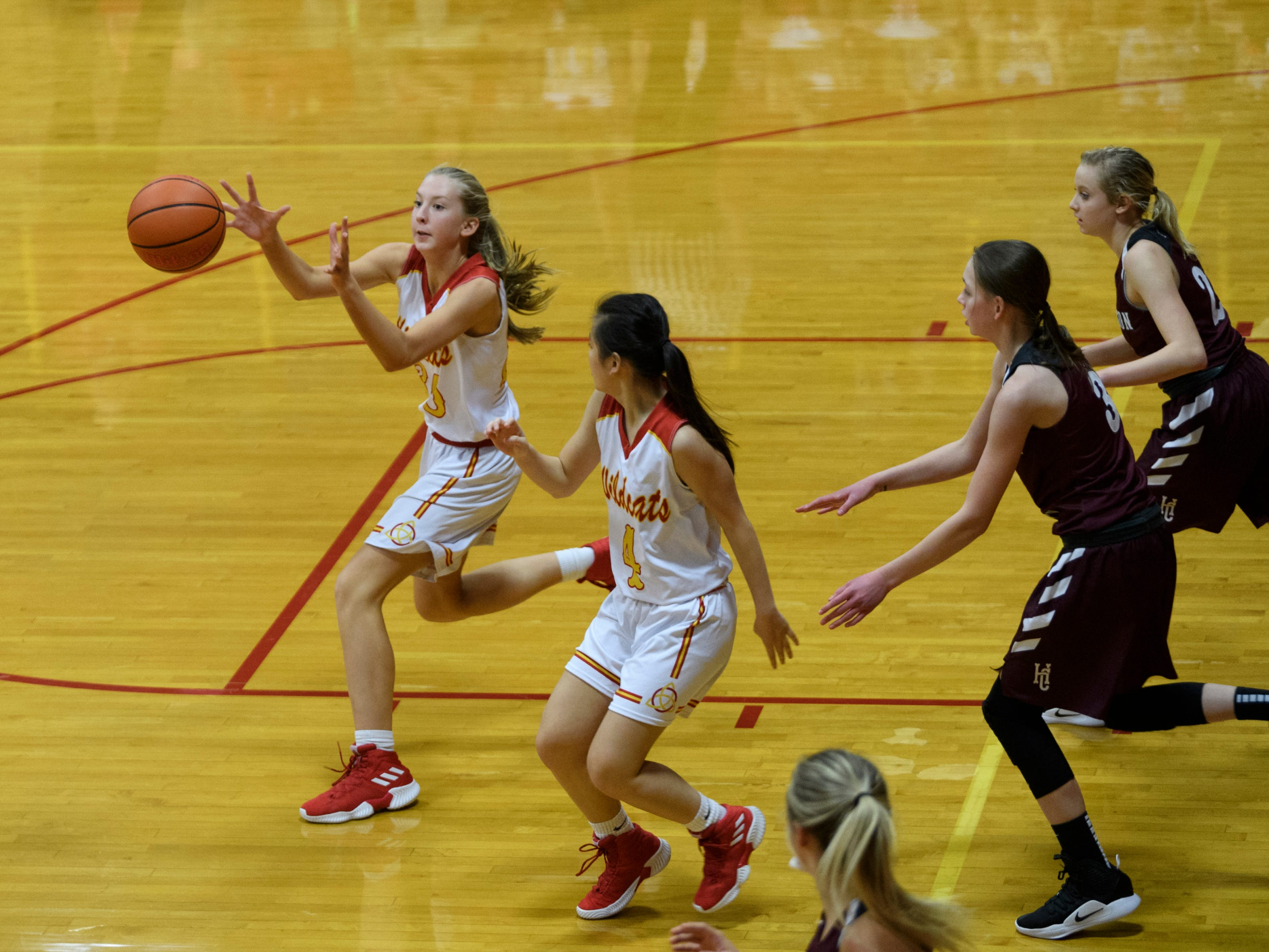 Mater Dei's Kennedy Wenger (30) receives a pass during the fourth quarter at Mater Dei High School in Evansville, Tuesday, Dec. 11, 2018. The Lady Colonels defeated the Wildcats 53-40.
