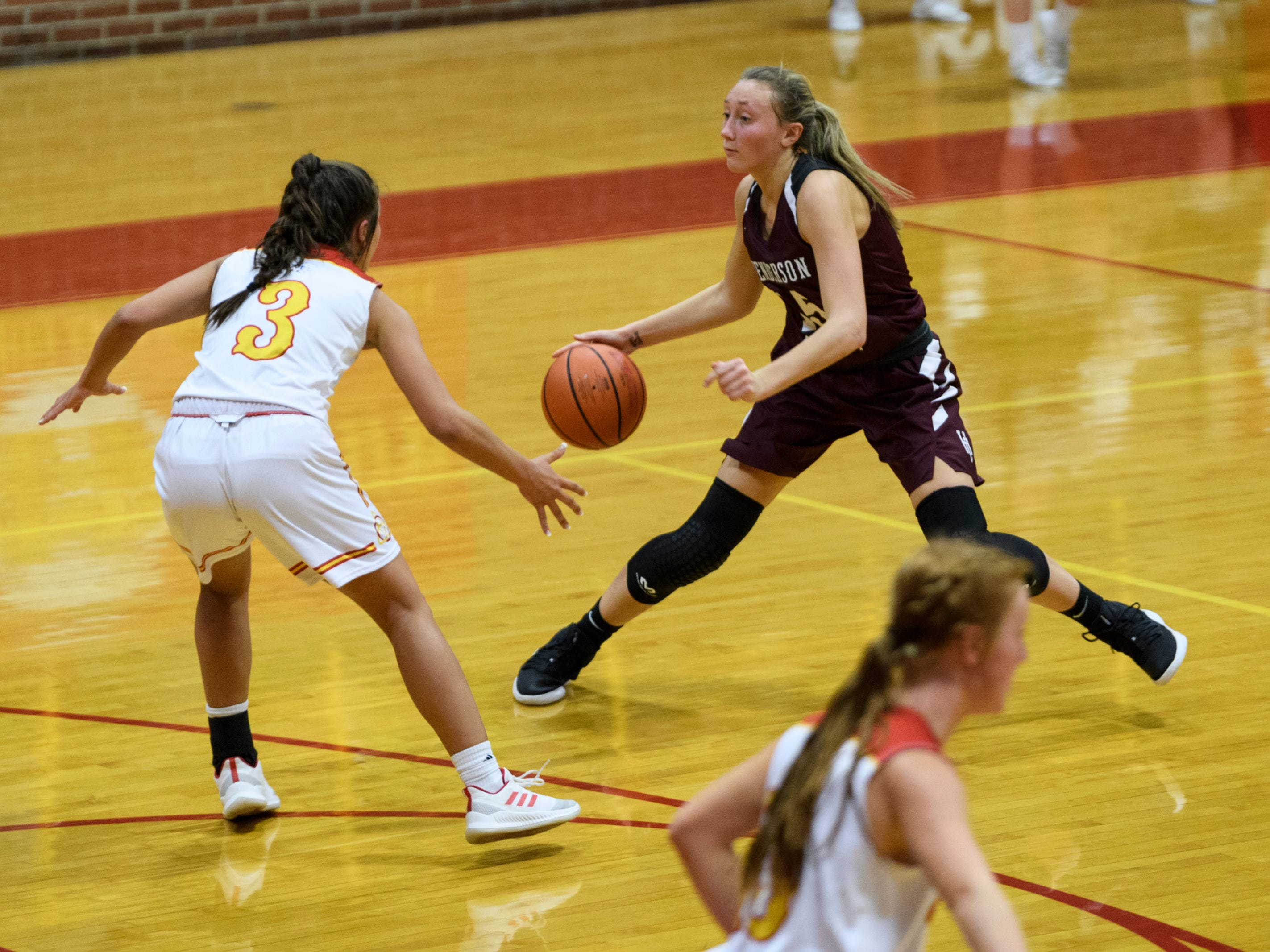 Mater Dei's Hannah Winiger (3) guards Henderson County's Alyssa Dickson (15) during the second quarter at Mater Dei High School in Evansville, Tuesday, Dec. 11, 2018. The Lady Colonels defeated the Wildcats 53-40.