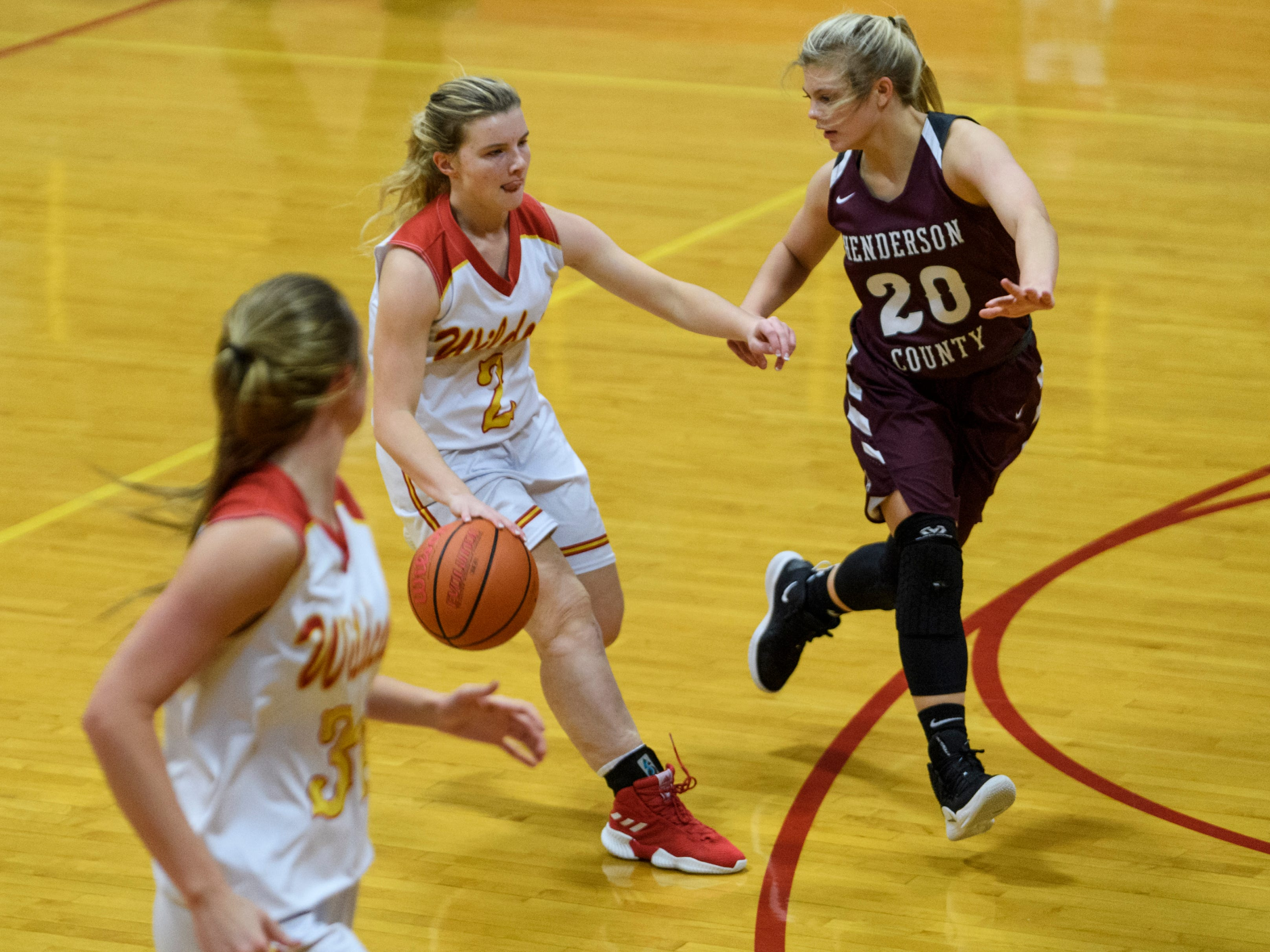 Mater Dei's Anna Boring (2) advances down the court as Henderson County's Kaytlan Kemp (20) attempts to stop her during the fourth quarter at Mater Dei High School in Evansville, Tuesday, Dec. 11, 2018. The Lady Colonels defeated the Wildcats 53-40.