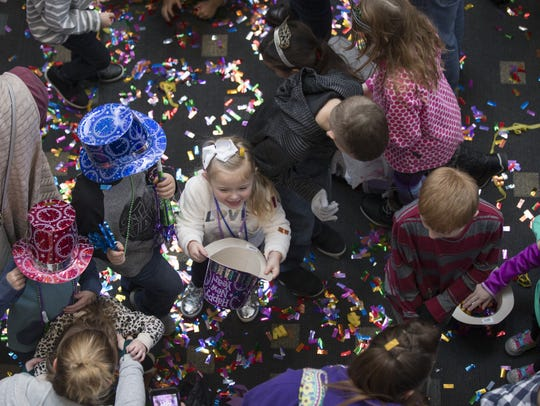 Kids play with confetti during last year's 'Countdown to Noon' celebration at the Children's Museum of Indianapolis.