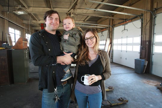 Tuesday November 19th, 2013, Jonathan Brooks and his wife Ashley Brooks hold their son Roman, inside  the future location of their fine dining, breakfast/brunch restaurant, Milktooth, 540 Virginia Ave.  (Michelle Pemberton/The Star)