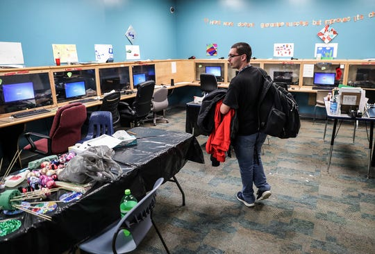 Senior Alec Deuel walks into his classroom at Damar Charter Academy in Indianapolis, where students have been working on a hands-on holiday project, Tuesday, Dec. 11, 2018. Deuel will likely become valedictorian of his class, after overcoming homelessness and learning barriers. His tuition to University of Indianapolis will be fully covered, in large part by the Senator Richard G. Lugar Award of Academic Distinction.