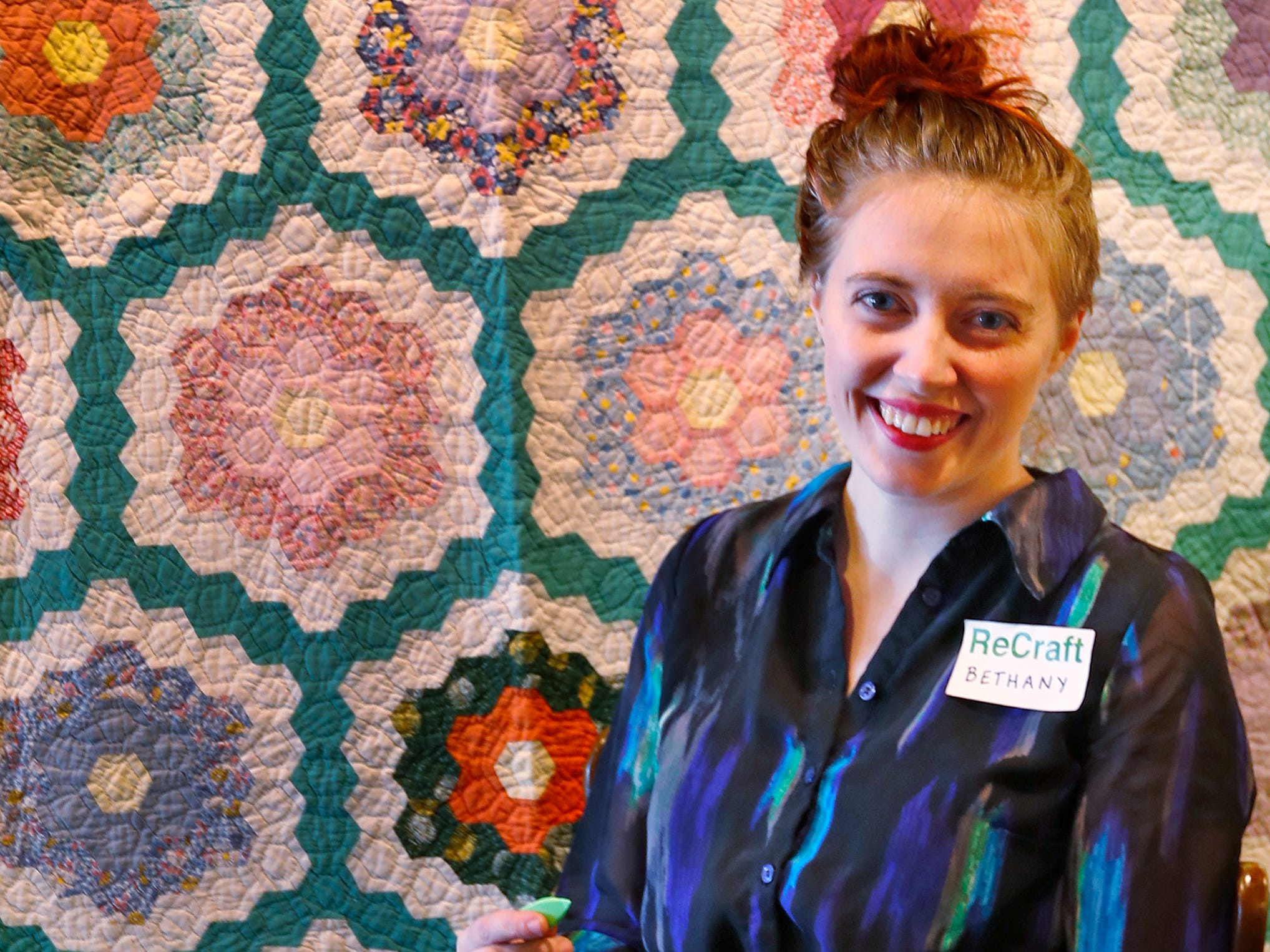 Bethany Daugherty is the owner of ReCraft, Tuesday, Dec. 11, 2018.  ReCraft was born out of Daugherty's love of crafting and her interest in environmental activism.  At the secondhand craft and hobby store, Daugherty also teaches workshops.  Sustainability and environmentalism are the focus of the store.  This day at ReCraft is Giving Back Day.  Customers are welcomed to come in to knit or crochet hats and scarves for the homeless.