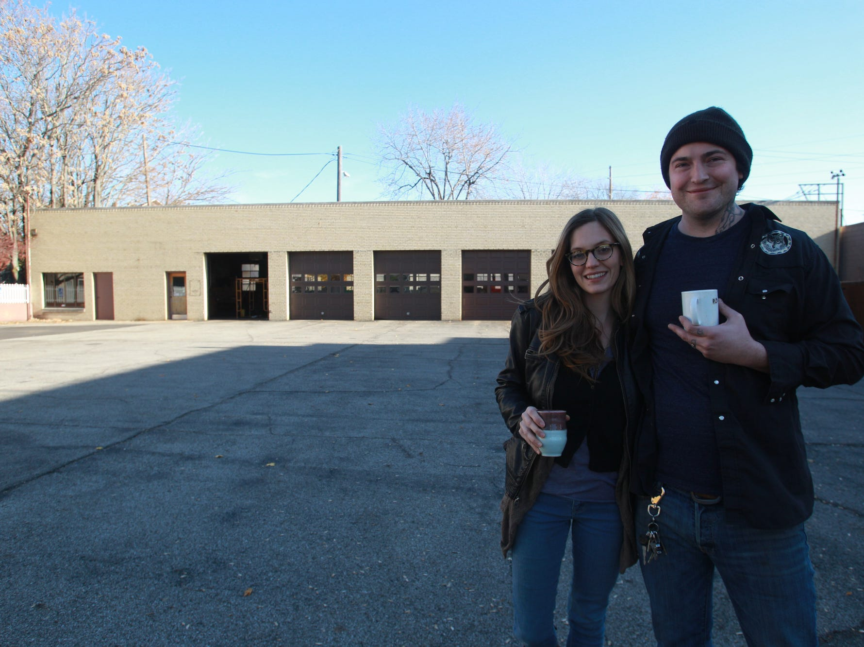 Tuesday November 19th, 2013, Jonathan Brooks and his wife Ashley Brooks stand in the parking lot of Milktooth, 540 Virginia Ave.  The future location of their fine dining, breakfast/brunch restaurant, coming in 2014.  (Michelle Pemberton/The Star)