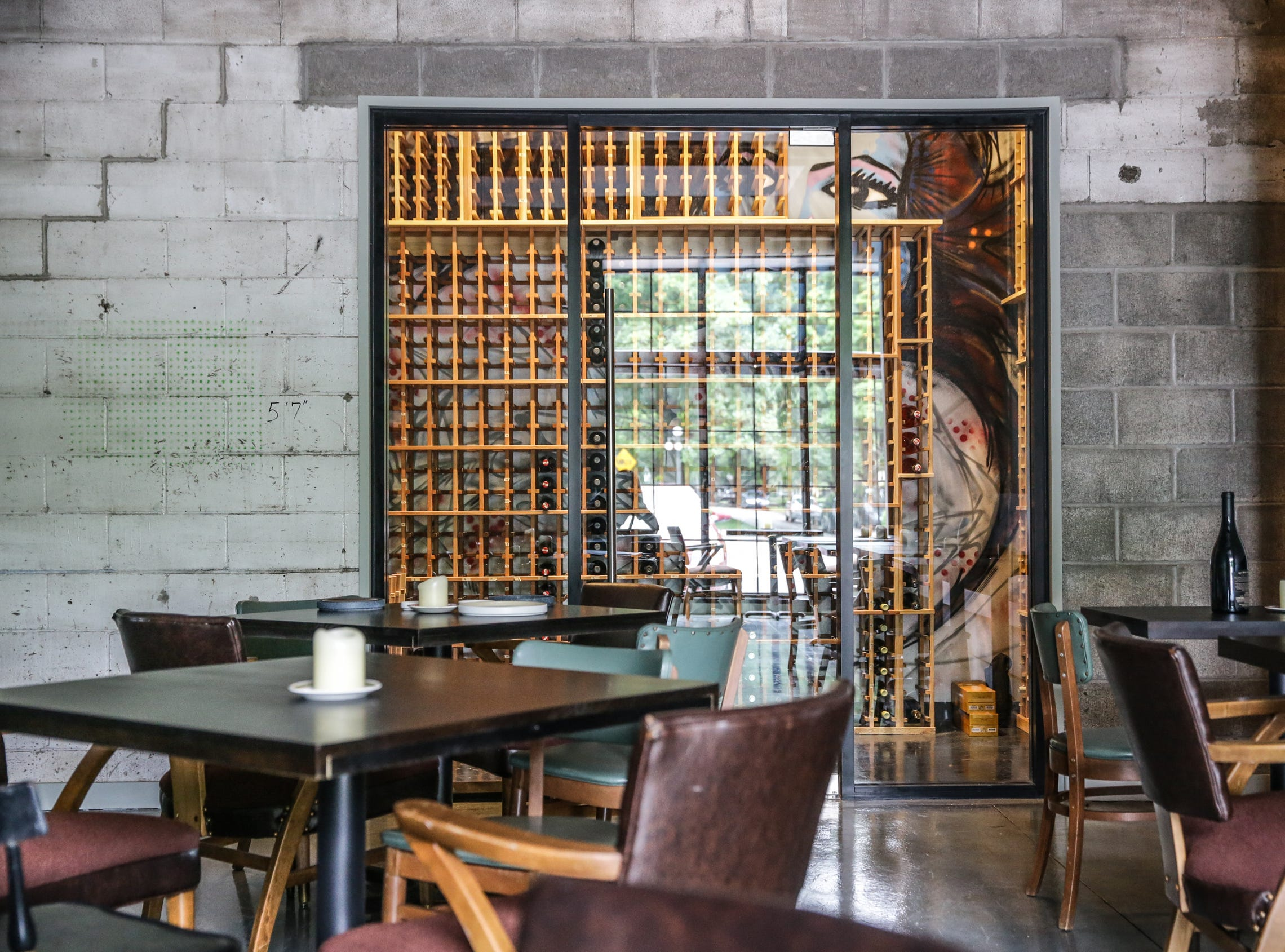 A wine cellar features graffiti art at Beholder, a new restaurant by Milktooth owner and Chef Jonathan Brooks, Tuesday, June 12, 2018. Beholder is located at 1844 E. 10th St. in Indianapolis.