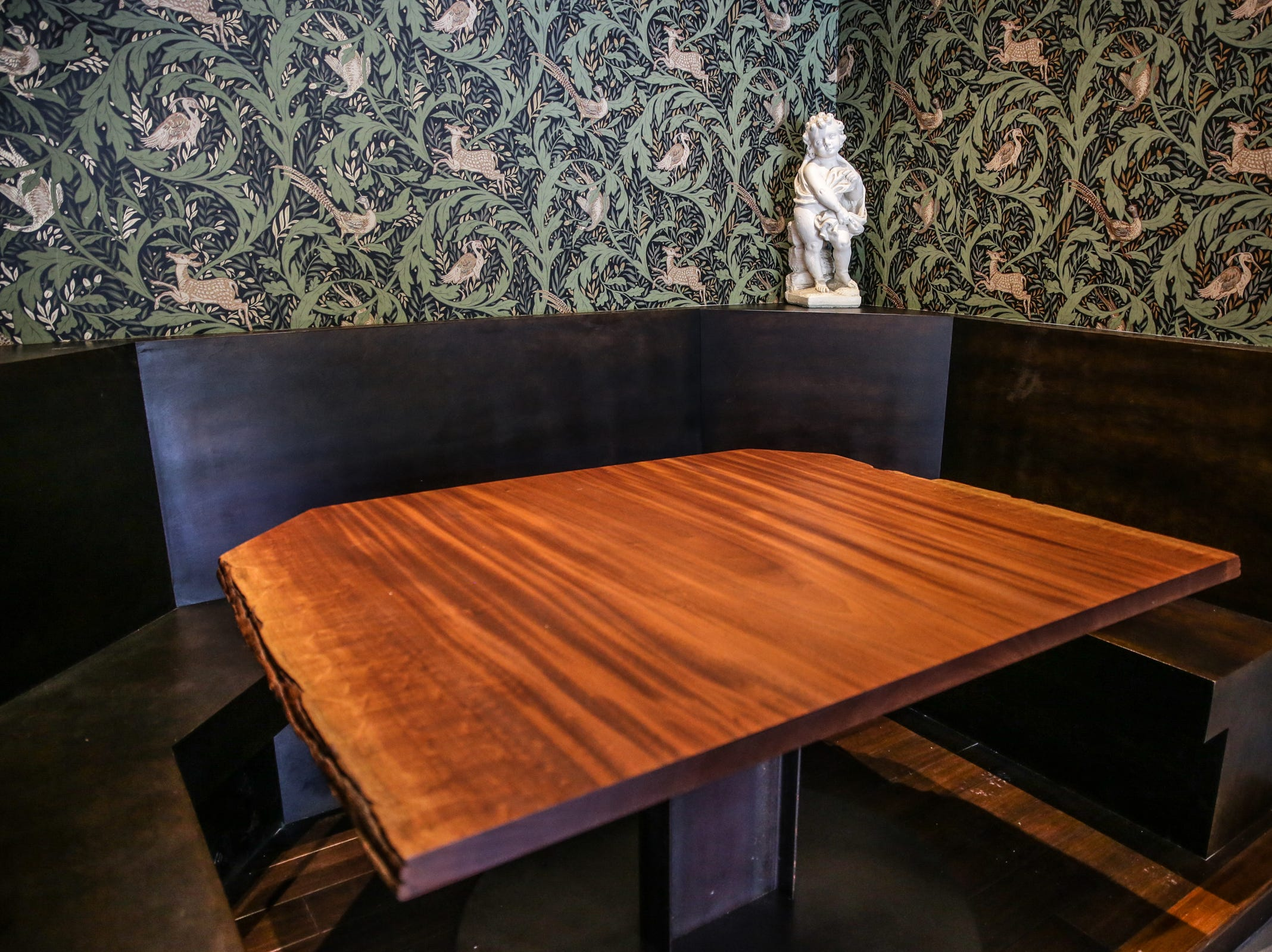 "A live edge table created by Donald Mee, of Donald Mee Design, is the centerpiece of the ""Champagne"" booth in Beholder, a new restaurant by Milktooth owner and Chef Jonathan Brooks, Tuesday, June 12, 2018. Beholder is located at 1844 E. 10th St. in Indianapolis."