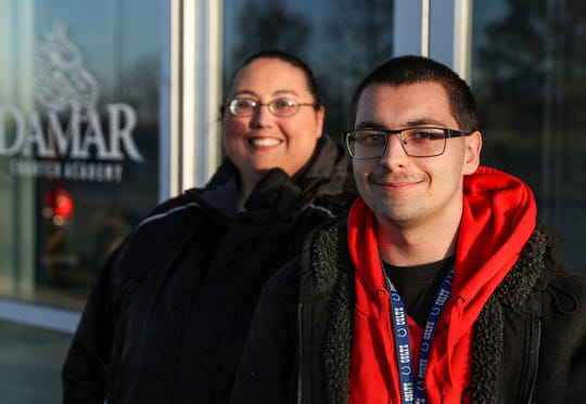 From right, Alec Deuel, a senior at Damar Charter Academy in Indianapolis, and his mother Jennifer Atkinson pose for portrait at the school on Tuesday, Dec. 11, 2018. Atkinson, a single mother, and Deuel stayed in a women and children's shelter for nearly a year beginning in October 2014. After overcoming homelessness and learning barriers related to his autism, Deuel will likely become valedictorian of his class. His tuition to University of Indianapolis will be covered by grants, merit-based scholarships and federal aid.