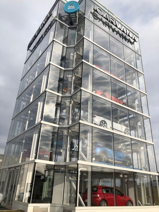 The seven-story Carvana car vending machine opens Thursday at 8130 Summit Hill Drive on the north side.