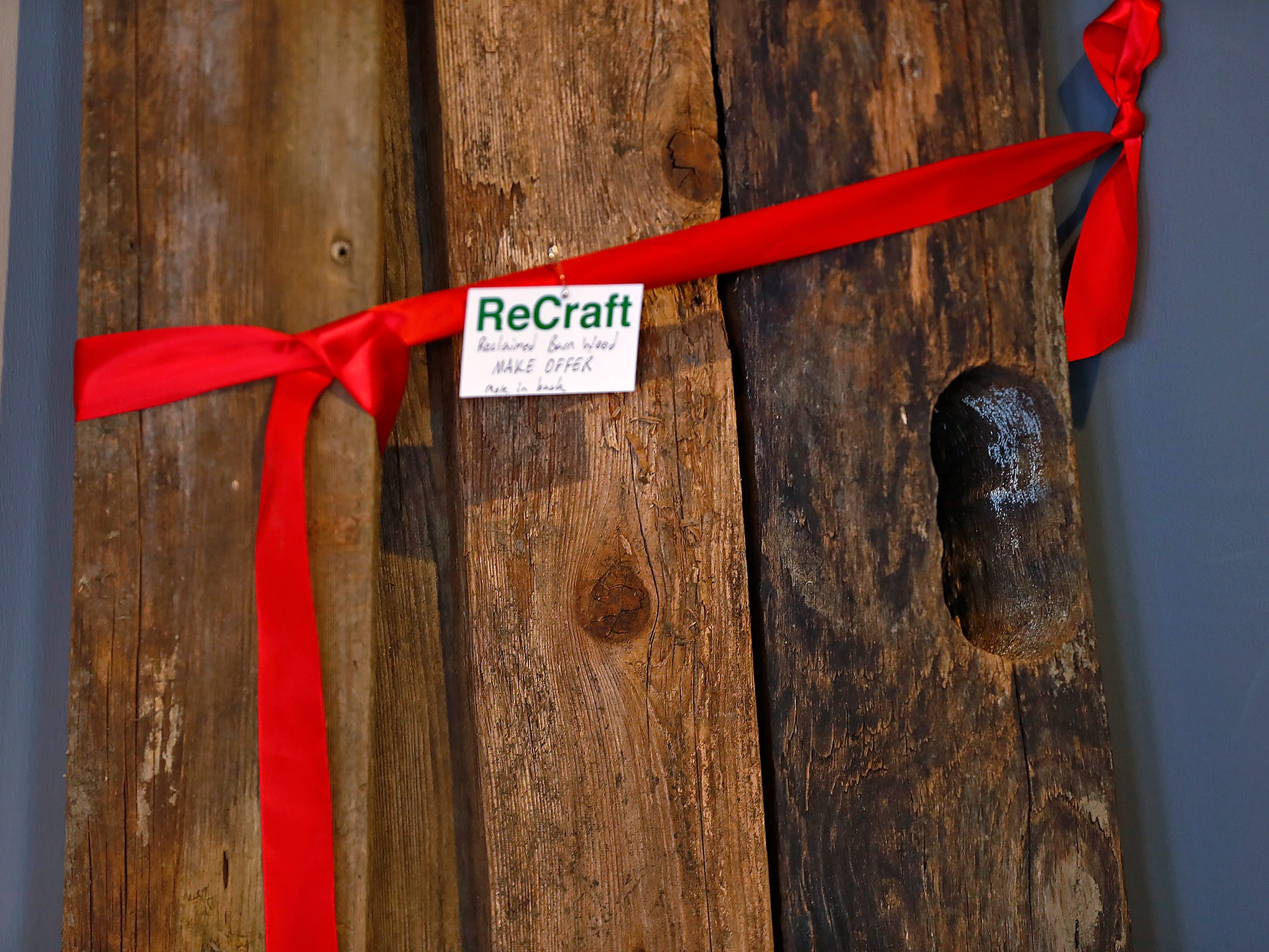 Reclaimed barn wood is seen for sale at ReCraft, Tuesday, Dec. 11, 2018.  Many of the store's items are donated or ready for re-use. ReCraft was born out of Bethany Daugherty's love of crafting and her interest in environmental activism.  At the secondhand craft and hobby store, Daugherty also teaches workshops.  Sustainability and environmentalism are the focus of the store.