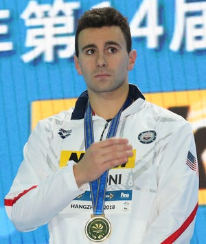 Gold medalist USA's Blake Pieroni looks on during ceremonies for the men's 200m freestyle at the 14th FINA World Swimming Championships in Hangzhou, China, on Wednesday, Dec. 12, 2018. (AP Photo/Ng Han Guan)