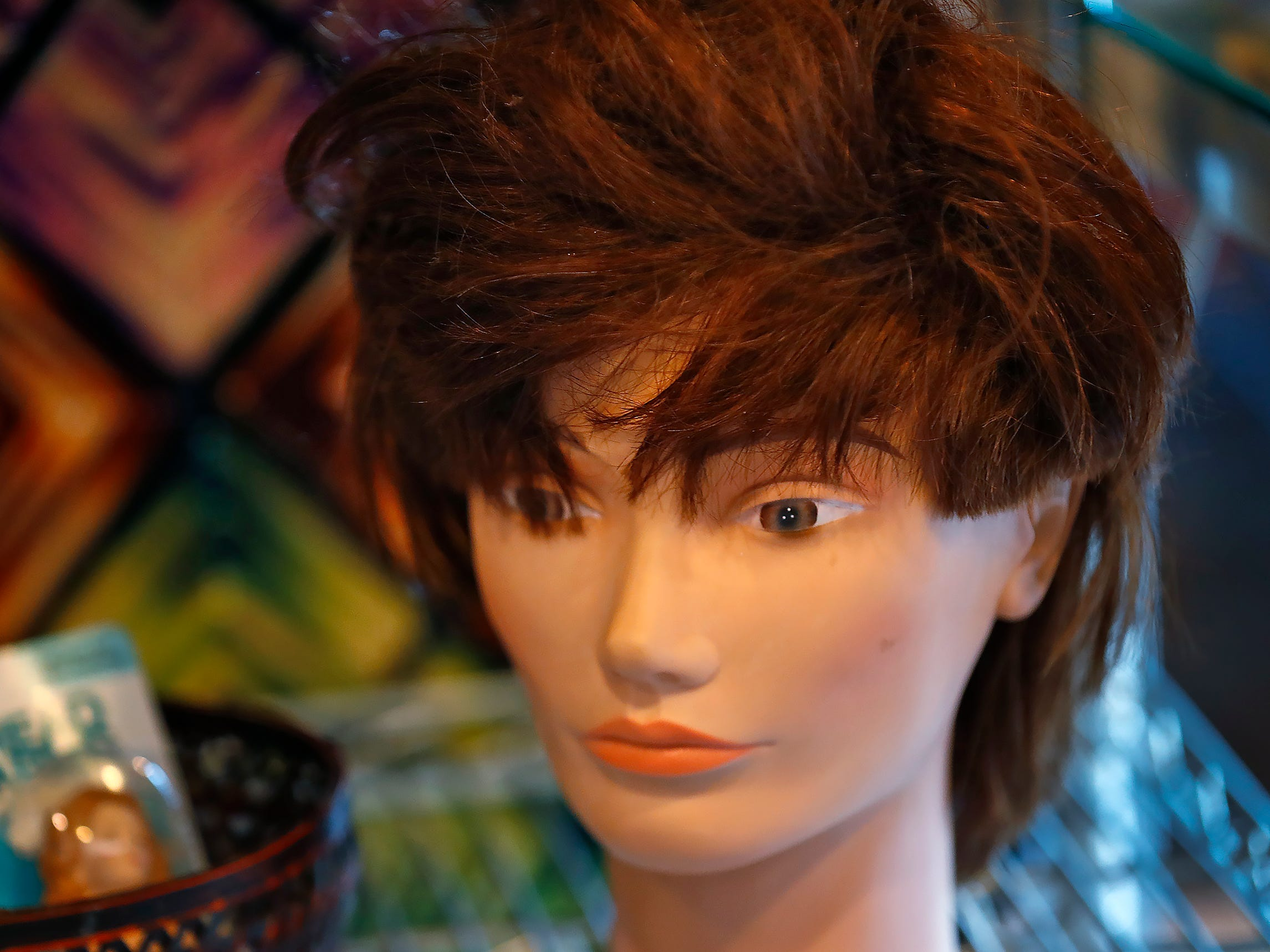 A mannequin head and wig are seen for sale at ReCraft, Tuesday, Dec. 11, 2018.  Many of the store's items are donated or ready for re-use. ReCraft was born out of Bethany Daugherty's love of crafting and her interest in environmental activism.  At the secondhand craft and hobby store, Daugherty also teaches workshops.  Sustainability and environmentalism are the focus of the store.