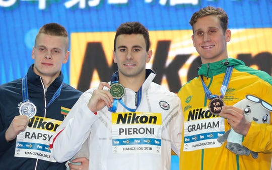 From left, silver medalist Lithuania's Danas Rapsys, gold medalist USA's Blake Pieroni and Australia's Graham Alexander pose during ceremonies for the men's 200m freestyle at the 14th FINA World Swimming Championships in Hangzhou, China, Wednesday, Dec. 12, 2018. (AP Photo/Ng Han Guan)
