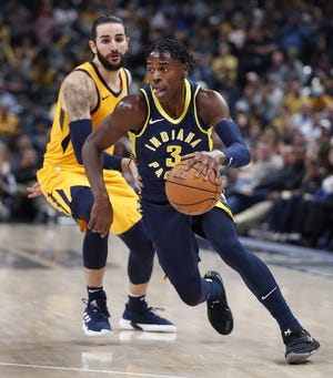 Indiana Pacers guard Aaron Holiday (3) drives by Utah Jazz guard Ricky Rubio (3) in the second half of their game on Monday, Nov. 19, 2018. The Pacers defeated the Jazz 121-94.
