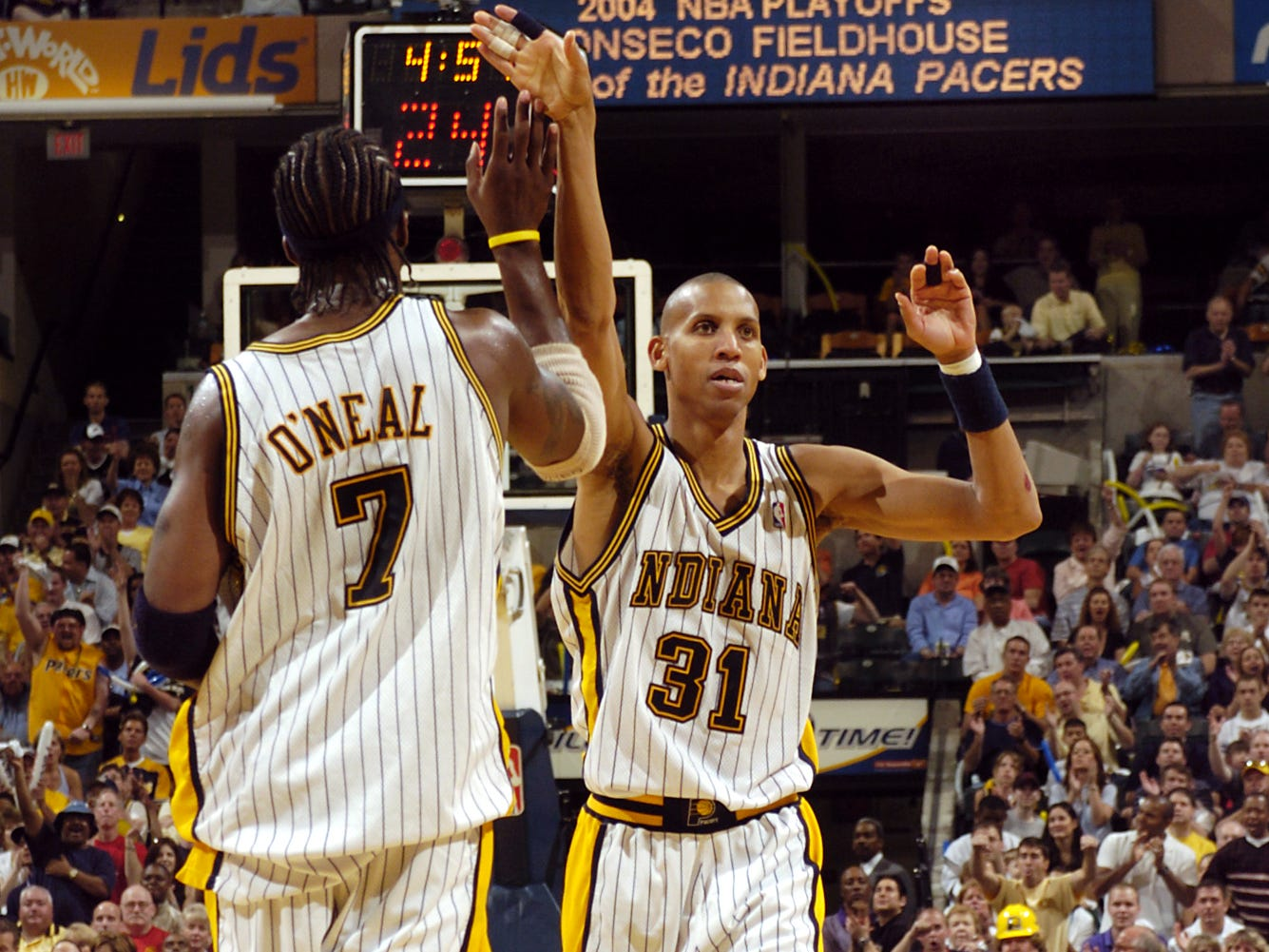 Jermaine O'Neal and Reggie Miller in 2004.