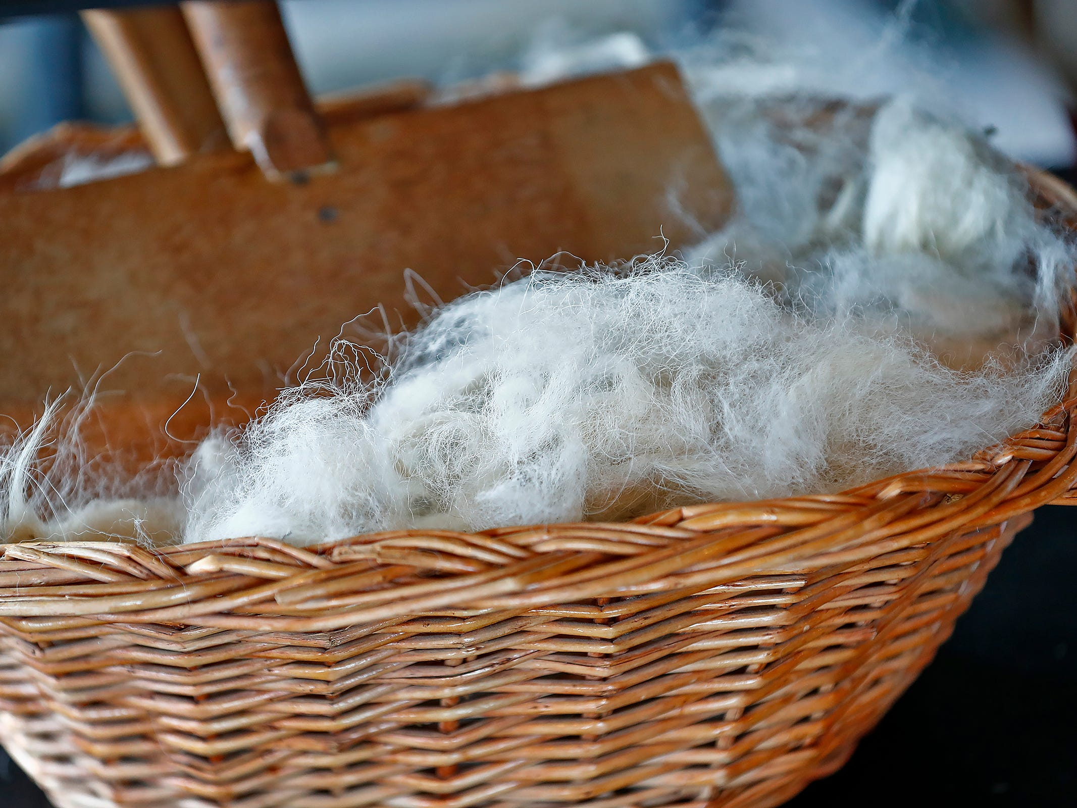 Unwashed sheep wool and carding combs are seen at ReCraft, Tuesday, Dec. 11, 2018.  Many of the store's items are donated or ready for re-use. ReCraft was born out of Bethany Daugherty's love of crafting and her interest in environmental activism.  At the secondhand craft and hobby store, Daugherty also teaches workshops.  Sustainability and environmentalism are the focus of the store.