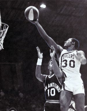 George McGinnis was a star at Indiana University  before joining the Pacers.  Charles A. Berry/IndyStar file photo George McGinnis (30) starred at IU for a season before joining the Pacers.