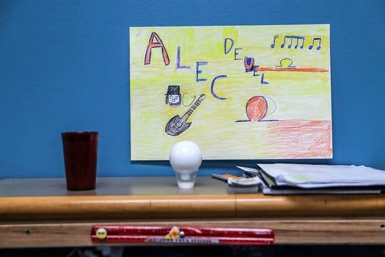 Senior Alec Deuel's desk marker is seen hanging in his classroom at Damar Charter Academy in Indianapolis, Tuesday, Dec. 11, 2018. Deuel will likely become valedictorian of his class, after overcoming homelessness and learning barriers. His tuition to University of Indianapolis will be fully covered, in large part by the Senator Richard G. Lugar Award of Academic Distinction.