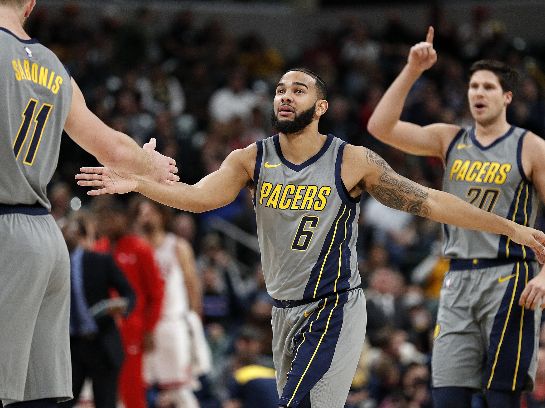 Indiana Pacers guard Cory Joseph (6) begins to celebratew with Domantas Sabonis (11) in 2018.