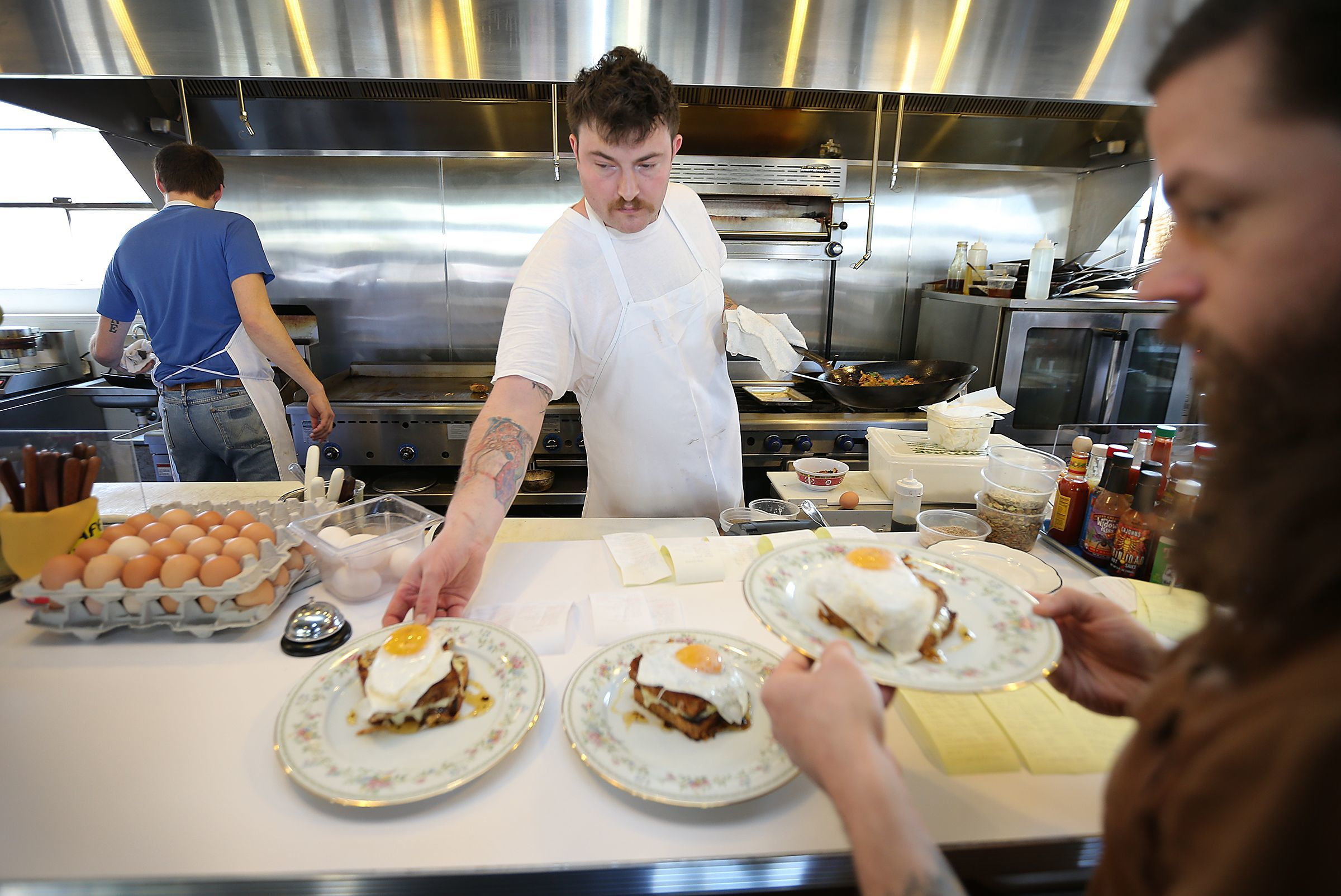 Milktooth owner Jonathan Brooks serves up three orders of the restaurant's cranberry walnut & local raclette grilled cheese.