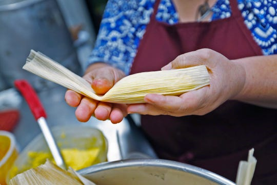 Maria Vasquez encloses a tamale in a corn husk, as she makes tamales, at Pico de Gallo restaurant, Tuesday, Dec. 11, 2018.  The family is making the traditional food for the Carmel Farmer's Market.