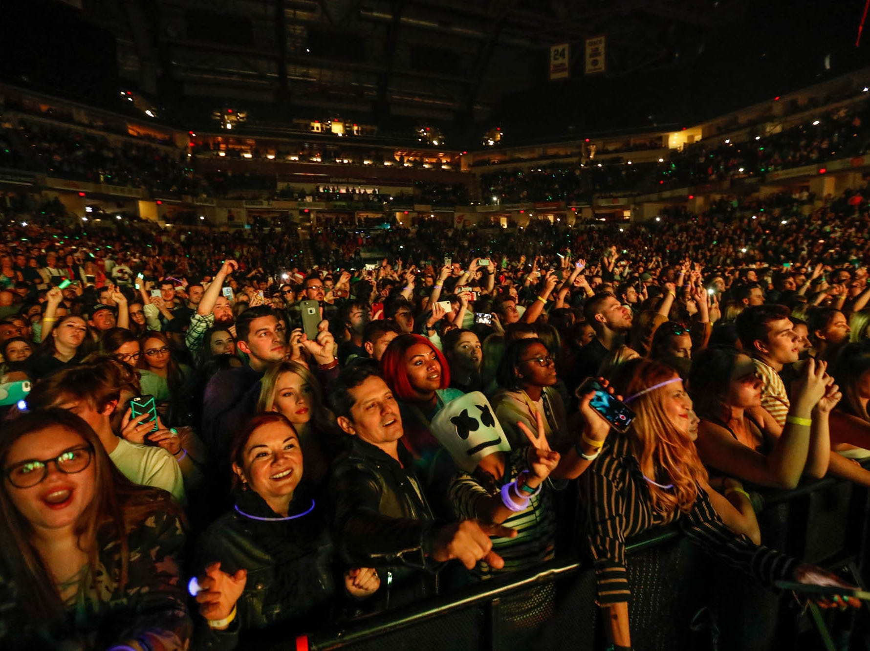 Fans rock out to music by the Chainsmokers, Marshmello, and  Bebe Rexha during the 2018 Jingle Jam concert at Bankers Life Fieldhouse in Indianapolis on Tuesday, Dec. 12, 2018.