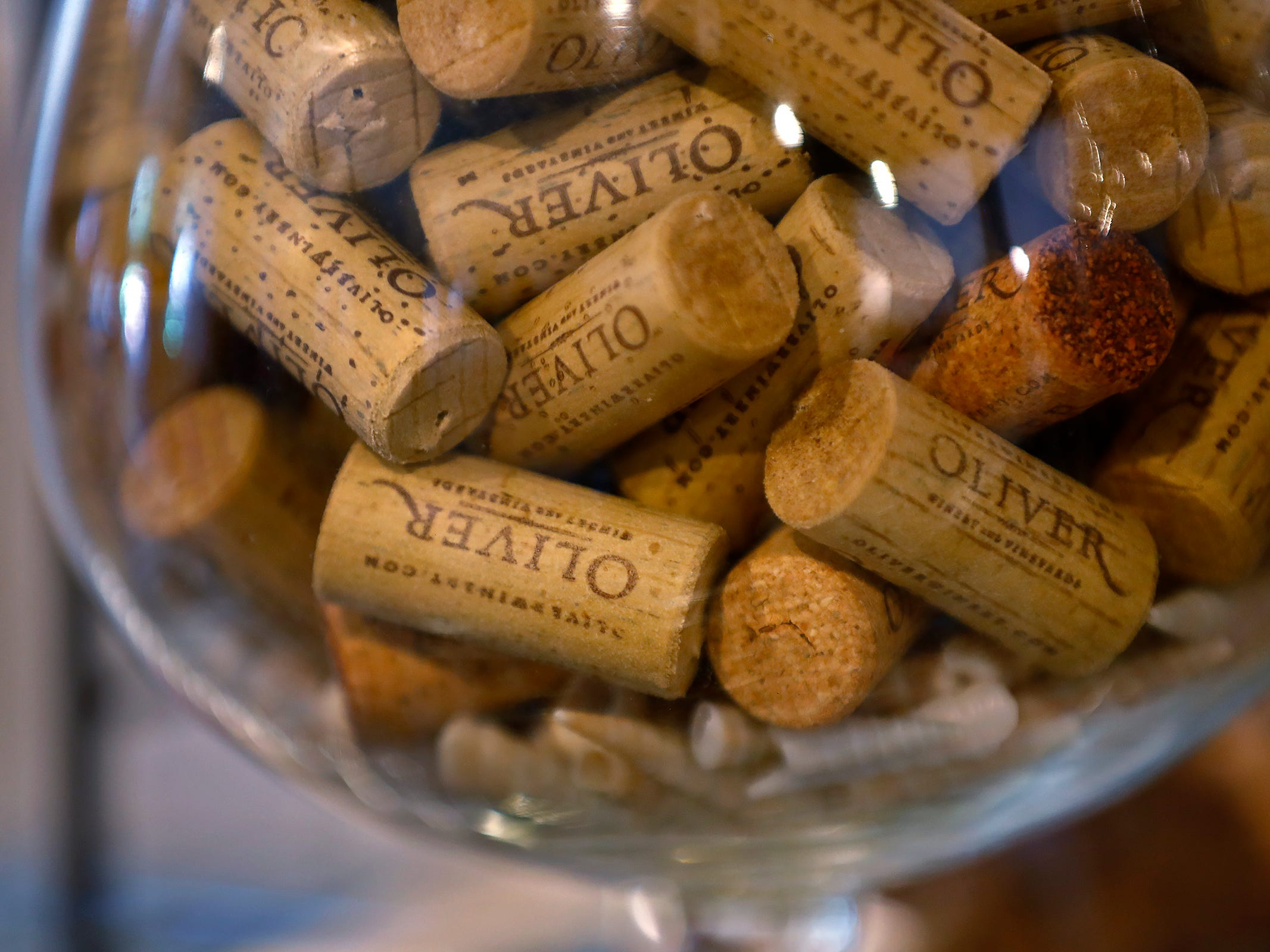 A collection of Oliver Winery corks are seen at ReCraft, Tuesday, Dec. 11, 2018.  The items are among the variety of donated things that can be used in crafting.  ReCraft was born out of Bethany Daugherty's love of crafting and her interest in environmental activism.  At the secondhand craft and hobby store, Daugherty also teaches workshops.  Sustainability and environmentalism are the focus of the store.