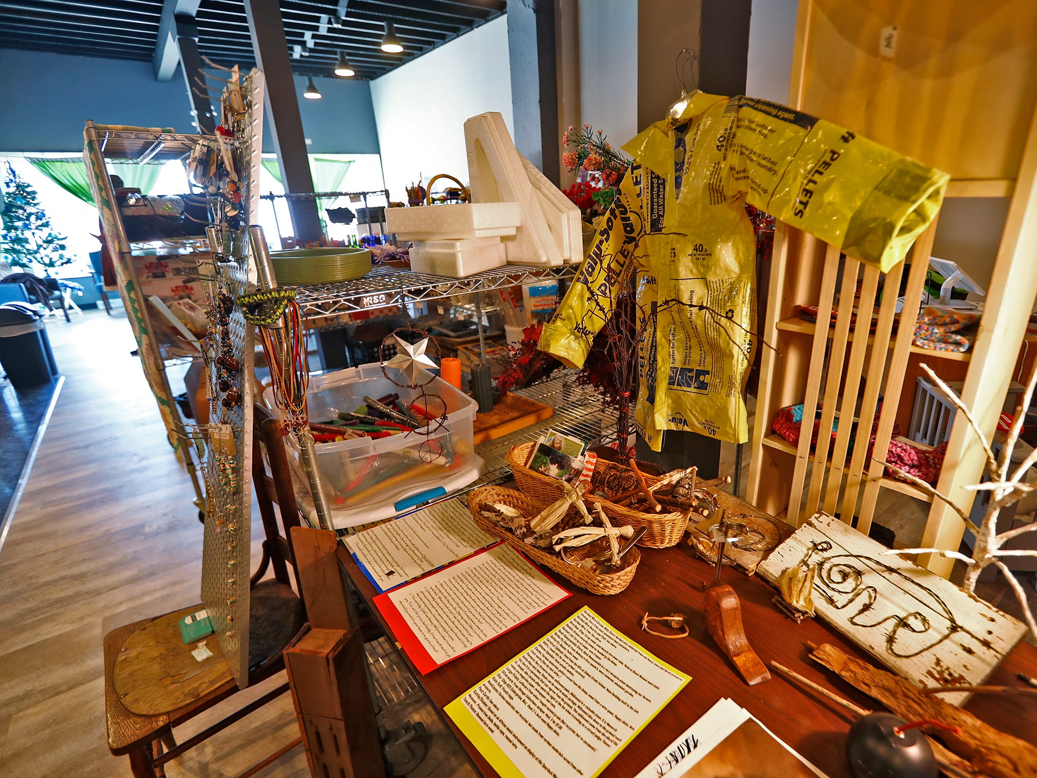 Crafts and art made by others are seen for sale in this corner at ReCraft, Tuesday, Dec. 11, 2018.  ReCraft was born out of Bethany Daugherty's love of crafting and her interest in environmental activism.  At the secondhand craft and hobby store, Daugherty also teaches workshops.  Sustainability and environmentalism are the focus of the store.