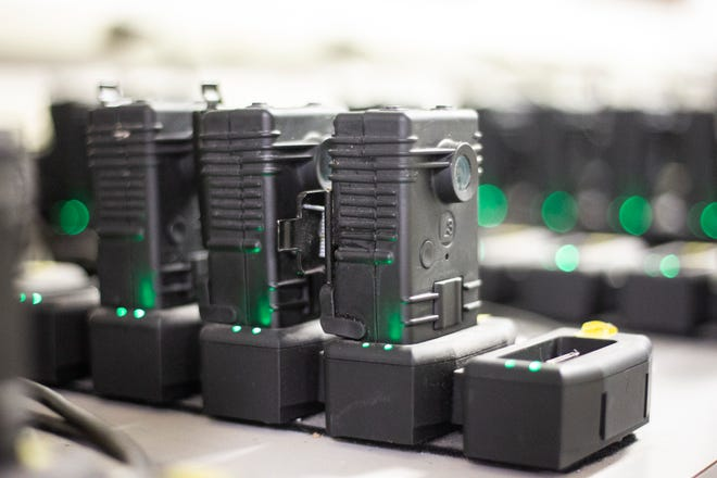 Police body cameras charge on Oct. 31, 2018.