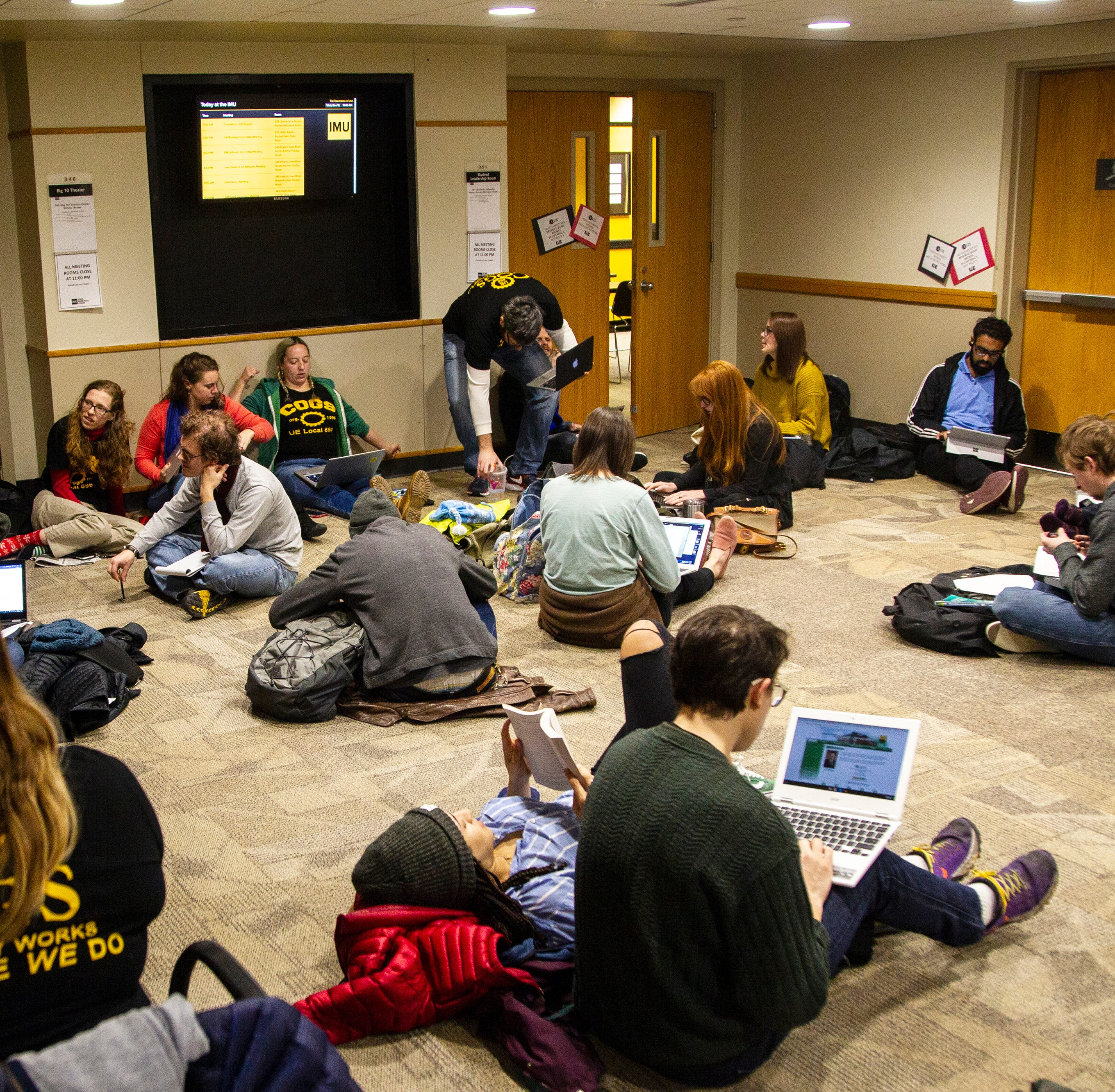 'Give and take' means something different to UI grad student union, Iowa regents