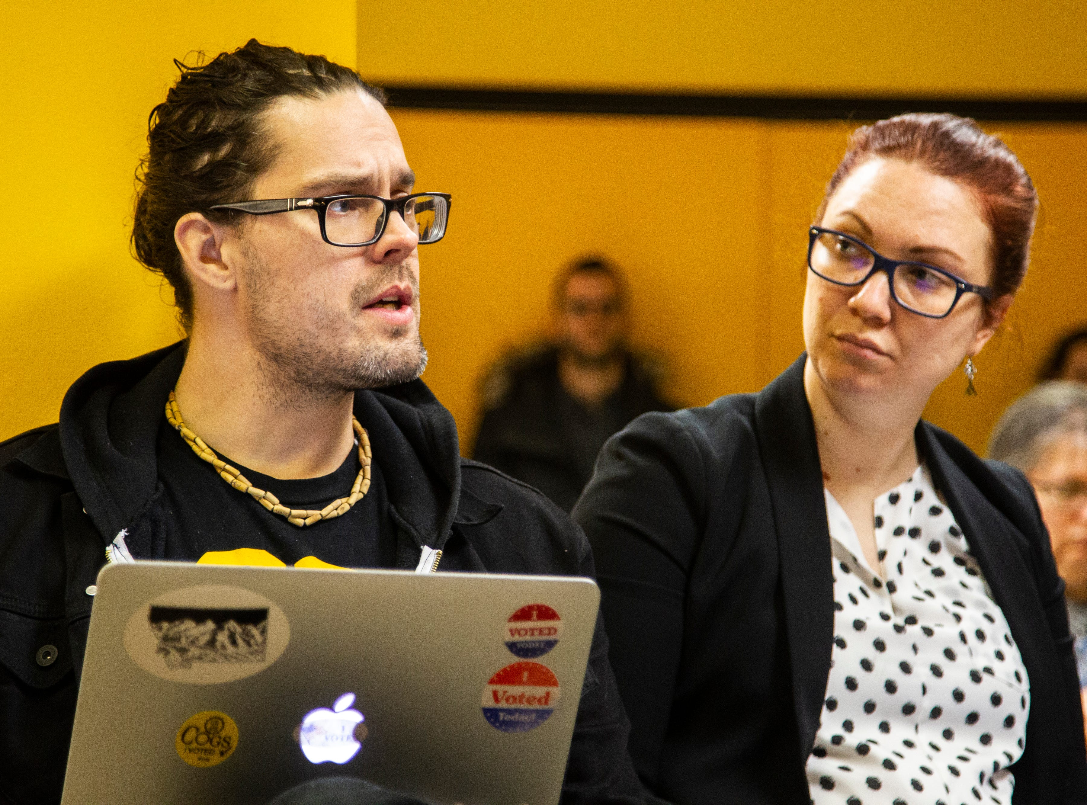 John Jepsen, a Campaign to Organize Graduate Student member, speaks after receiving a contract proposal from the Iowa Board of Regents while Kezia Walker-Cecil, a COGS blue-area steward, listens on Wednesday, Dec. 12, 2018, at the Iowa Memorial Union in Iowa City.