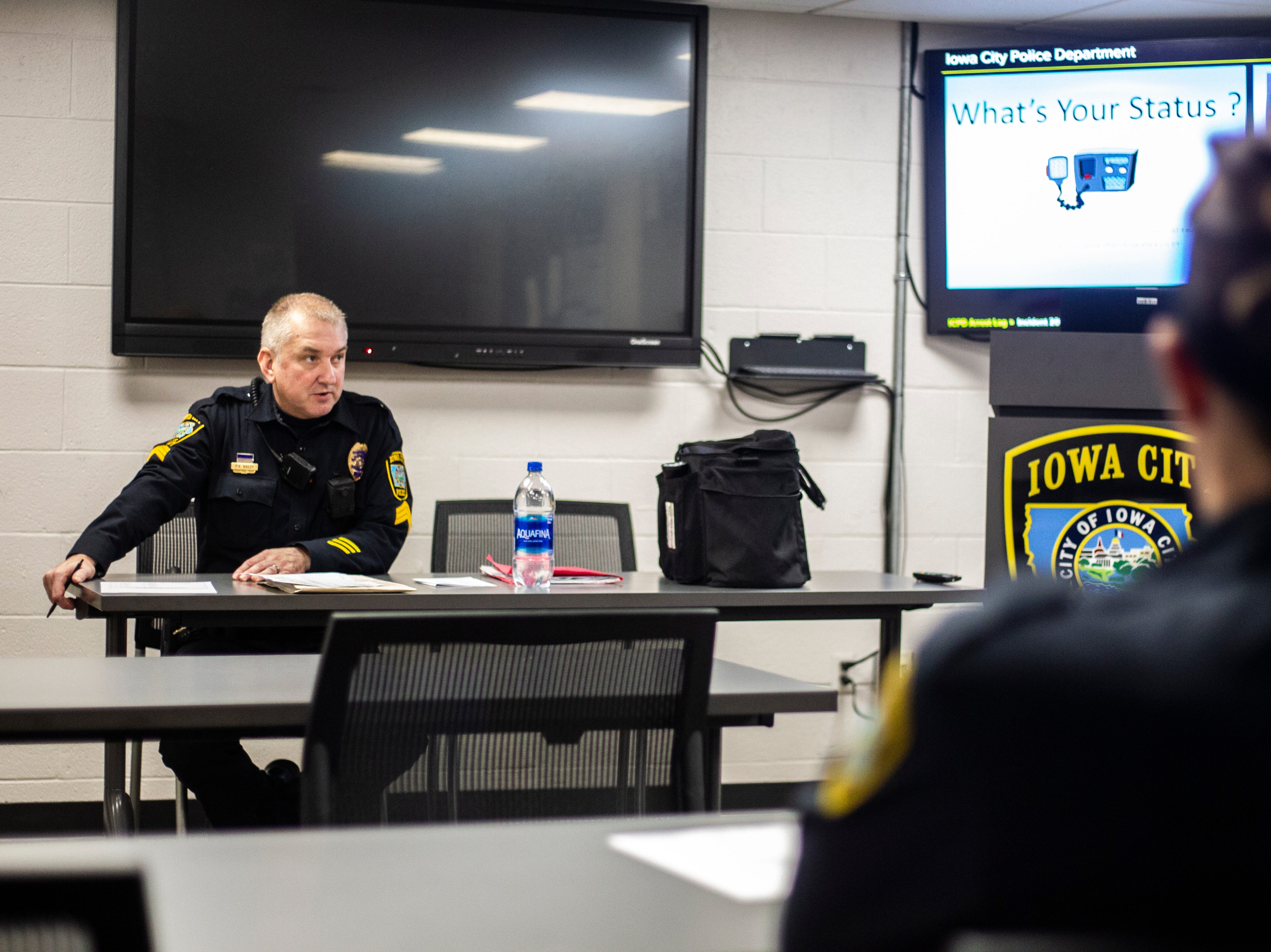 Iowa City Police third shift Watch Commander, Sergeant Kevin Bailey, talks with officers on Wednesday, Oct. 31, 2018, at the Iowa City Police Department in Iowa City.