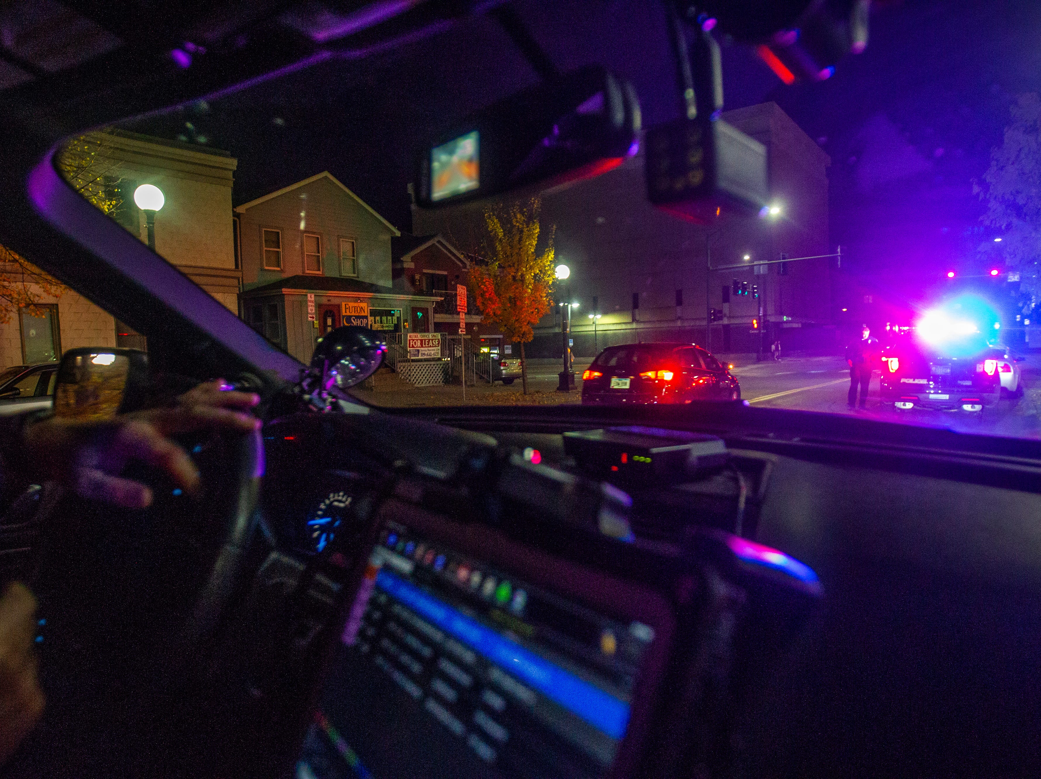 An Iowa City Police Officer conducts a traffic stop on Wednesday, Oct. 31, 2018, along S. Linn Street in Iowa City.