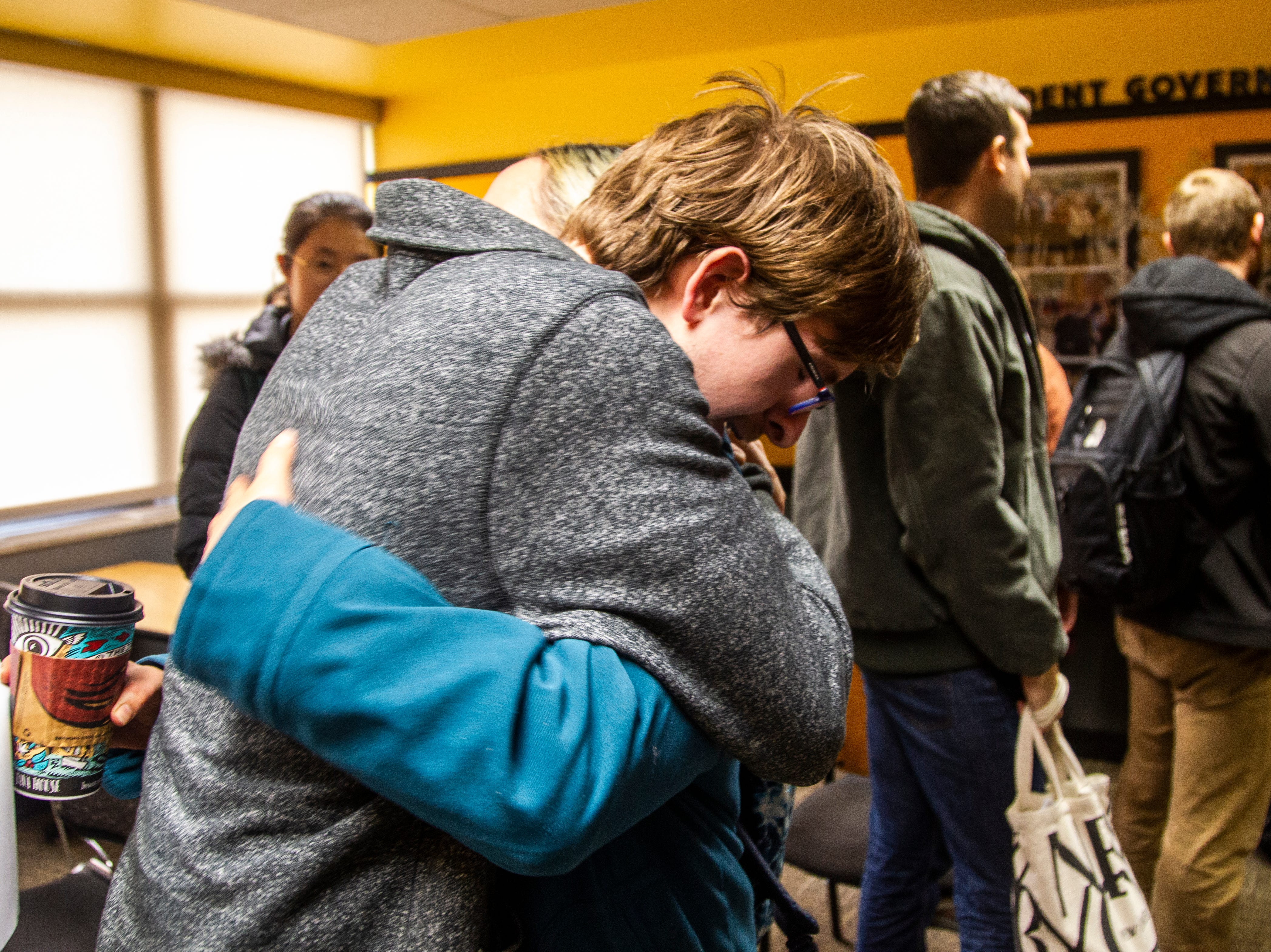 Erik Gustafson, a Campaign to Organize Graduate Students steward, is embraced by a friend after a contract proposal from the Iowa Board of Regents on Wednesday, Dec. 12, 2018, at the Iowa Memorial Union in Iowa City.