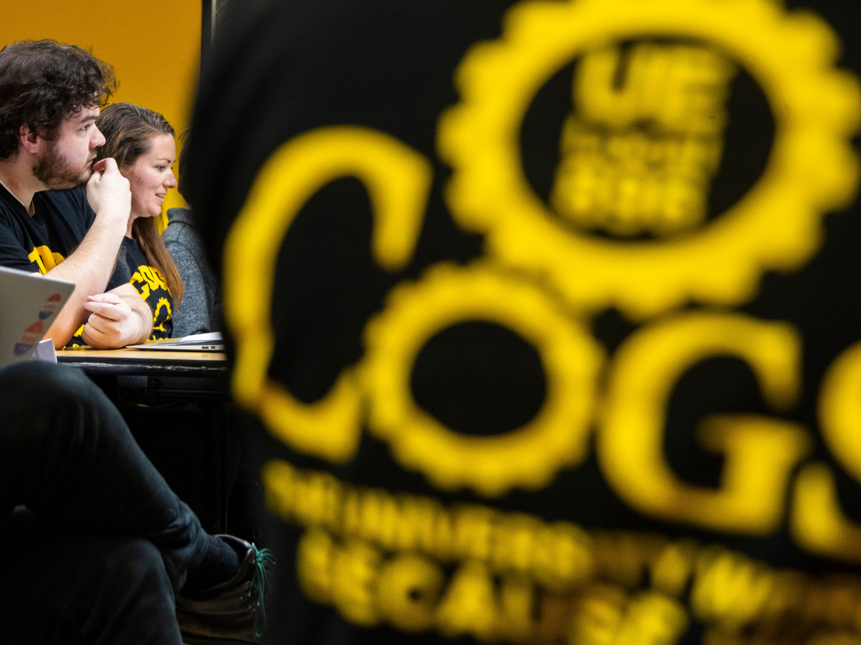 Campaign to Organize Graduate Students President (second from left) Laura Szech speaks during a contract proposal from the Iowa Board of Regents on Wednesday, Dec. 12, 2018, at the Iowa Memorial Union in Iowa City.