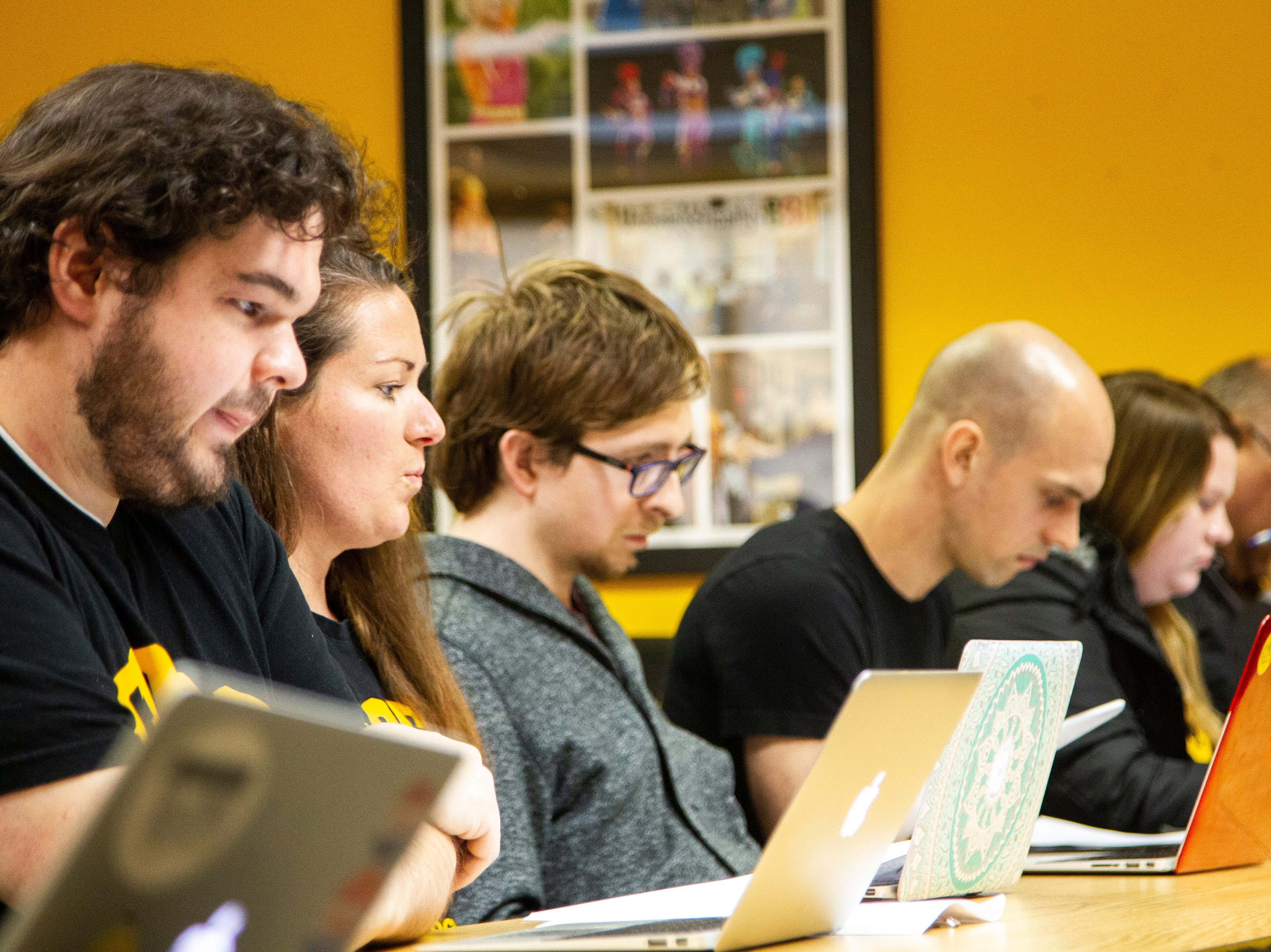 Campaign to Organize Graduate Students President Laura Szech (second from left) speaks during a contract proposal from the Iowa Board of Regents on Wednesday, Dec. 12, 2018, at the Iowa Memorial Union in Iowa City.