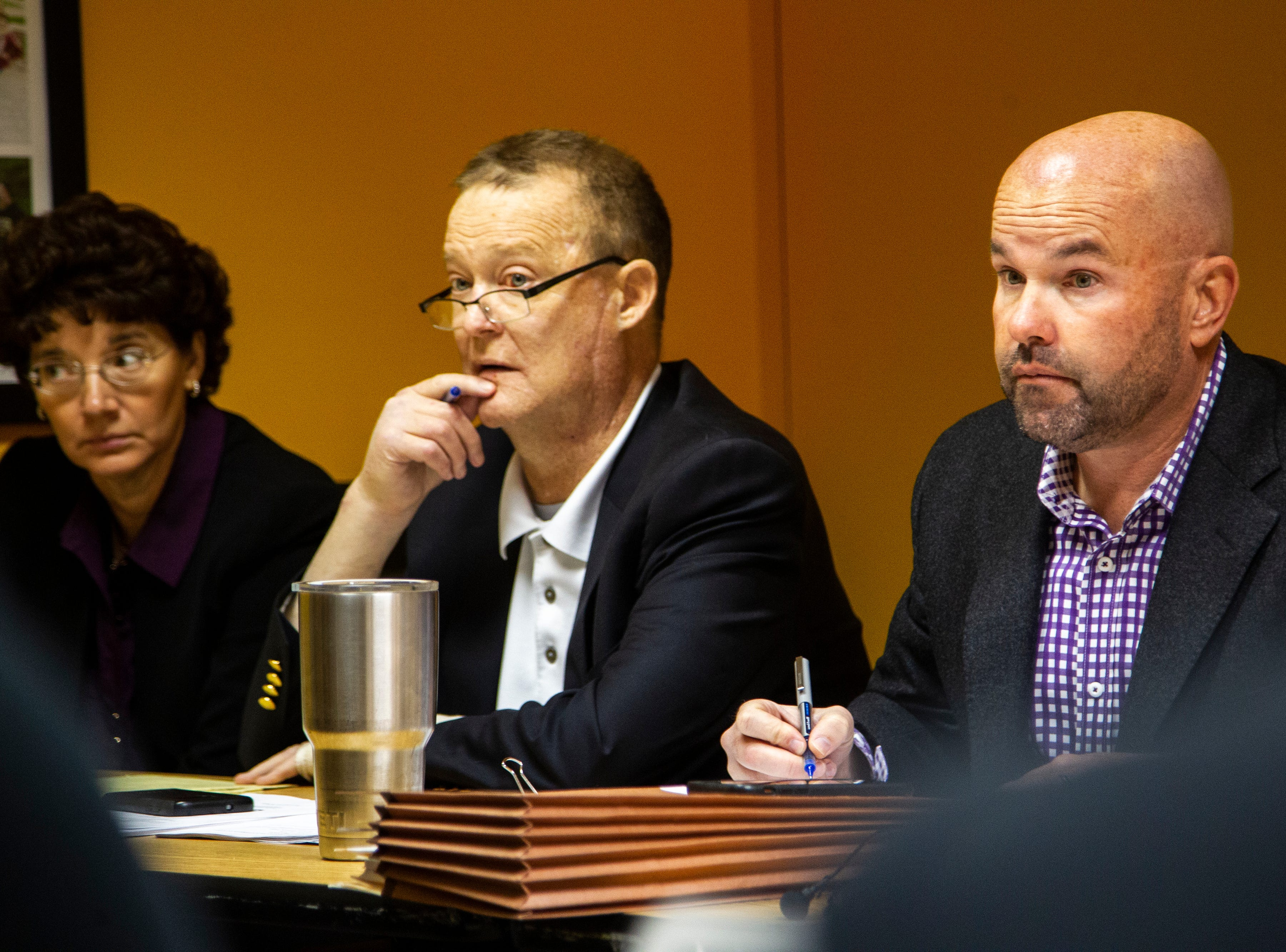 Regents lawyer Mike Galloway, right, takes notes during a contract proposal from the Iowa Board of Regents on Wednesday, Dec. 12, 2018, at the Iowa Memorial Union in Iowa City.