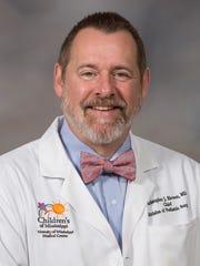Dr. Christopher J. Blewett