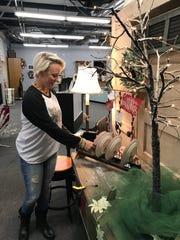 Aly Bonds of Brandon straightens merchandise at Antique Aly in Ridgeland.
