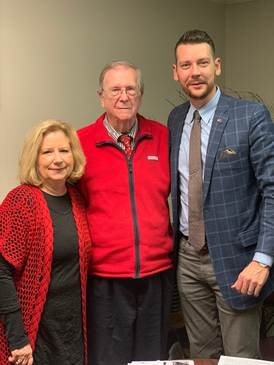 Judy Vailes (left), Reggie Smith (center) and Joey Hale (right) take a photo together after they completed the sale of Town and Country Realtors.  Jackson, TN. Dec. 10, 2018.