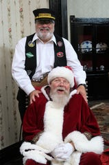 Clark Shaw, owner of the Old Country Store, dressed as a train conductor as he greeted and welcomed everyone to the Polar Express, even taking a picture with Santa Claus (Dee Moss) at the Casey Jones Village on Saturday, Dec. 1, 2018.