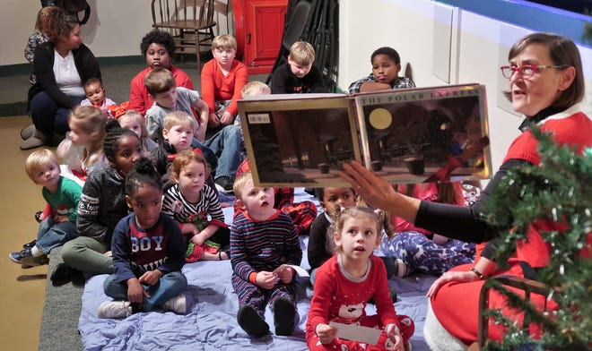 Children watched the movie and listened to a reading of Chris Van Allsburg's 'The Polar Express' by Judy LaFont at the Casey Jones Village on Saturday, Dec. 1, 2018.